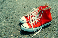 Red sneaker on black background. vintage color Stock Photos