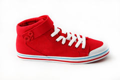 Red sneakers. Red shoes on a white background Stock Photos