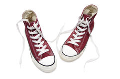 Red sneakers. Pair of  new red sneakers isolated on white background Royalty Free Stock Photo