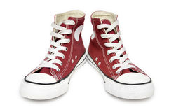 Red sneakers. Pair of  new red sneakers isolated on white background Stock Photo
