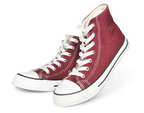 Red sneakers. Pair of  new red sneakers isolated on white background Royalty Free Stock Photography