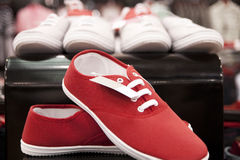 Red sneakers. Exposed on the shelf. Shallow depth of field royalty free stock photos