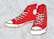 Red sneakers. Isolated on gray abstract background Royalty Free Stock Photo