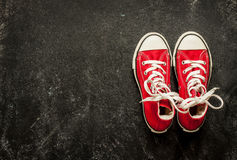 Red sneakers on black chalkboard - sports Stock Photos