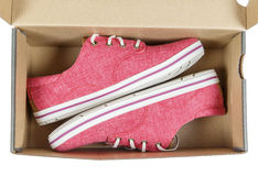 Red Sneakers on box. Royalty Free Stock Photo