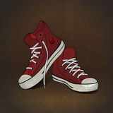 Red sneakers on grunge background Stock Photos