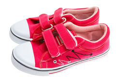 Red sneakers isolated on white Royalty Free Stock Photos