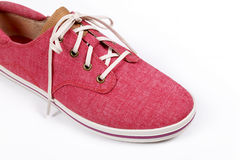 Red sneakers isolated on a white background. Royalty Free Stock Images