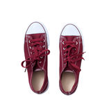 Red sneakers isolated on white background, top view close up. Red sneakers on wooden white floor background, top view closeup stock images