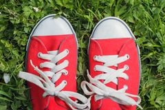 Red sneakers outdoors Stock Photo