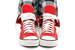 Red sneakers over white. Stock Photo