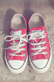 Red sneakers. Vintage style image Stock Photo