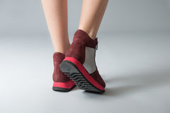 Red sneakers on woman legs Royalty Free Stock Photography