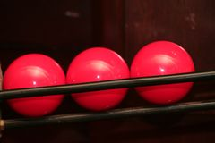 Red snooker balls. In pocket rail Royalty Free Stock Image