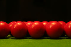 Red snooker balls. Close-up of red snooker balls on green table Stock Photography