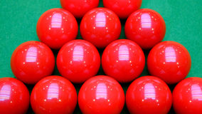 Red snooker balls and green table Royalty Free Stock Photos