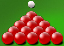 Red snooker balls triangle. Close up illustration of red snooker balls in triangle shape on green with white ball in background Royalty Free Stock Images