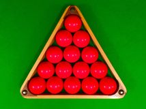 Red snooker balls in triangle. On Green baize table Royalty Free Stock Image