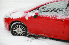 Red snow covered car Stock Image