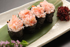 Red snow crab loosened kimbap on green leaf tray in restaurant. Deliciously Stock Image