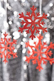 Red snow flake on a silver glitter background Stock Photo