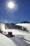 Red snow groomer in the mountain Royalty Free Stock Photos