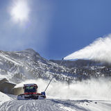Red snow groomer in the mountain Stock Images