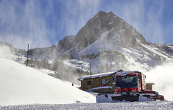 Red snow groomer in the mountain Stock Photo