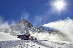 Red snow groomer in the mountain Royalty Free Stock Images