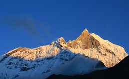 Red snow peak of Machhapuchhare, the fish tail, in the sunset, Pokhara, Nepal.  Stock Photos