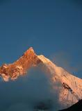 Red snow peak of Machhapuchhare, the fish tail, in the sunset, Pokhara, Nepal.  Stock Photo