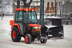 Red Snow Removal Tractor in City Stock Image