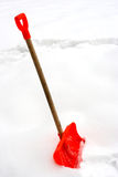 Red snow shovel Royalty Free Stock Image
