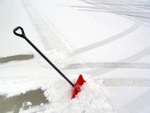 Red Snow Shovel. In pile of snow Stock Image