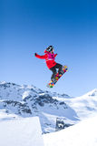Red Snowboarder Mid Air. Snowboarder competing in competition in Val Thorens, France Royalty Free Stock Photo
