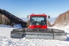Red snowcat on ski slopes Royalty Free Stock Photo