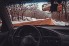 Red snowed road because of ore Stock Photography