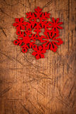 Red snowflake as ornament on wooden table Stock Photography