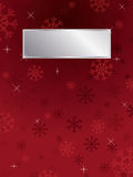 Red snowflake background. Red snowflake christmas background with silver plaque ready for text Stock Image