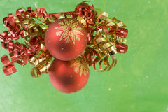 Red snowflake bauble green background Royalty Free Stock Photos