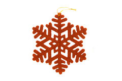 Red snowflake on white background Stock Image