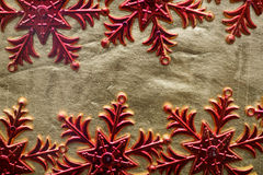 Red snowflakes on a gold background. Festive background Stock Photography