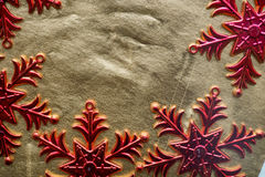 Red snowflakes on a gold background. Festive background Stock Images