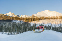 Red snowmobile in the mountains Stock Image