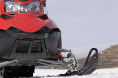 Red snowmobile in winter mountains Royalty Free Stock Photography