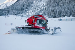 Red Snowplow and Snow Stock Photography