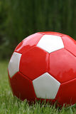 Red soccer ball Stock Images