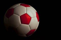 Red soccer ball. On dark background Stock Photo