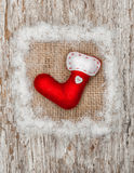 Red sock with burlap textile and snow Royalty Free Stock Images