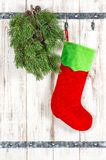 Red sock green christmas tree branch Vintage style decoration. Red sock and green christmas tree branch. Vintage style decoration royalty free stock photo